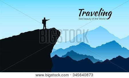 Mountains Landscape In Blue Colors. Silhouette Of Man On Rock On Mountains Background. Traveling And