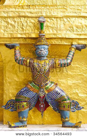 Giant Statue in Emerald Buddha temple Bangkok Thailand