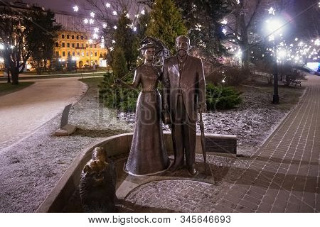 Riga, Latvia - January 14, 2018: Night Winter View Of The Sculpture Of George Armitstead With His Wi