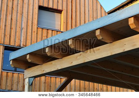 Woodwork At The Roof Of A Carport Near Residential Building
