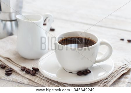Cup Of Coffee With Milk On A Wooden Background Close Up