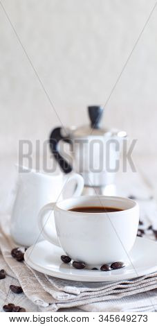 Cup Of Coffee With Milk On A White Wooden Background Close Up