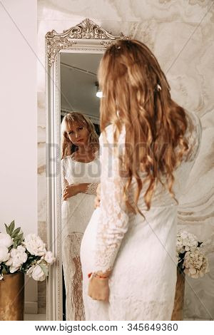 Beautiful Bride In Wedding Dress. Bride With Luxurious Hair And Makeup. Bride In Elegant White Dress