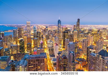 Chicago, IL, USA downtown cityscape from above at twilight.