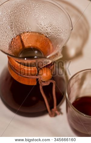15.01.2020. Kiev, Ukraine. Chemex With Strong And Fresh Black Coffee Of Beans Arabica Stands On Ligh