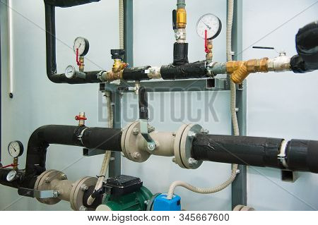 Manometer, Pipes And Faucet Valves Of Heating System