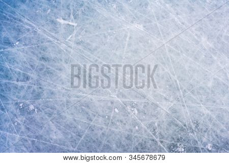 Ice Background With Marks From Skating And Hockey, Blue Texture Of Rink Surface With Scratches