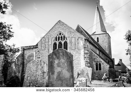 Rear Churchyard With Old Graves And Headstones In Pluckley, United Kingdom.