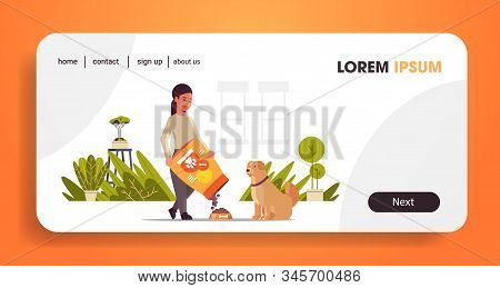 Woman Feeding Hungry Labrador Retriever Girl Giving Her Dog Dry Food Granules Domestic Life With Pet