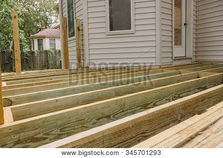 Building A Patio With Wooden Porch Terrace Flooring In Patio Outside The New House