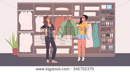 Fashion Stylist Helping Woman Picking Outfit In Changing Room Wardrobe With Different Stylish Shoes