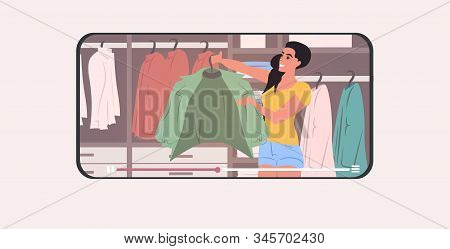Fashion Stylist Holding Jacket In Changing Room Wardrobe With Different Stylish Clothes Modern Dress