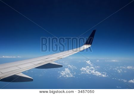 View Of An Airplane Wing At High Altitude