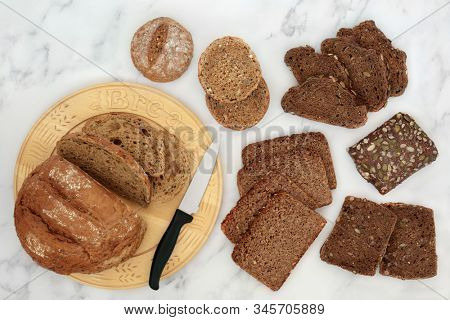 Low glycemic bread selection for diabetics high in antioxidants, smart carbs & omega 3 fatty acids. Below 55 on the GI index. Top view on marble.