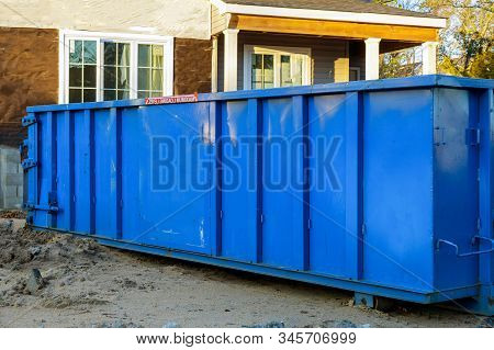 Trash Dumpsters A Large Container Filled With Industrial Garbage Bin