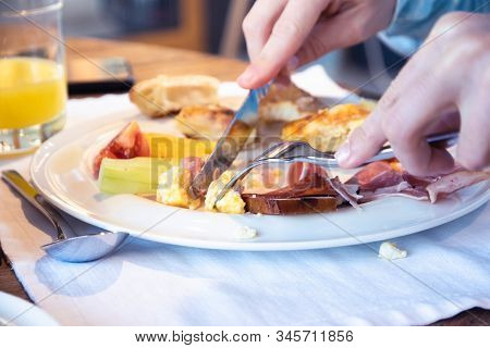 Close Up Of Hands Cutting Food. Healthy Food. Hotel Breakfast Food. Nutritious Food. Woman Eating Ho