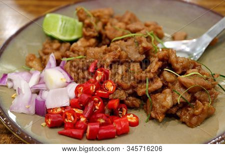 Plate Of Mouthwatering Stir Fried Pork With Shrimp Paste