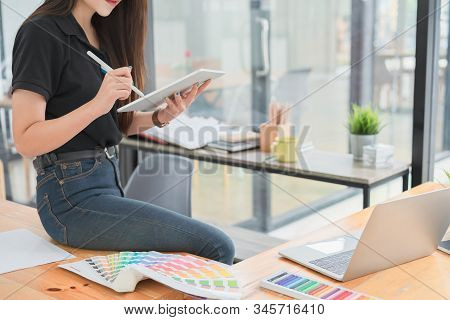 Cropped Shot Of Young Freelance Graphic Designer Hand Working With Stylus Pen On Mockup White Screen