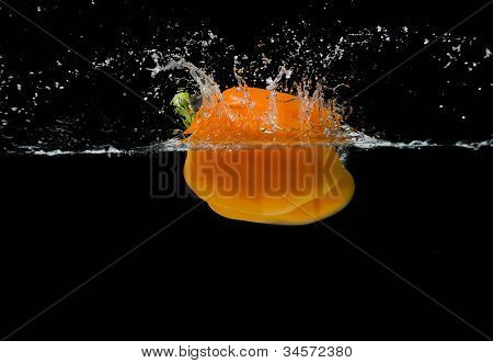 floating orange pepper splash