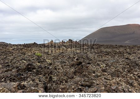 View At Volcanic Landscape In Timanfaya Nationalpark On Canary Island Lanzarote, Spain With Lava Fie
