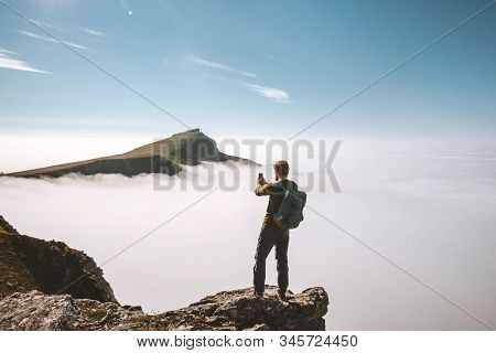 Man Blogger With Smartphone On Mountain Cliff Travel Vacations Adventure Content Creator Influencer