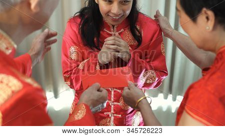 Daugther Give Red Envelop To Father Mother In Chiense New Year