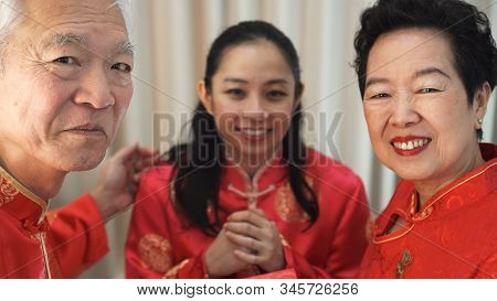 Chinese Family Happy Together In Chinese New Year Gathering Event