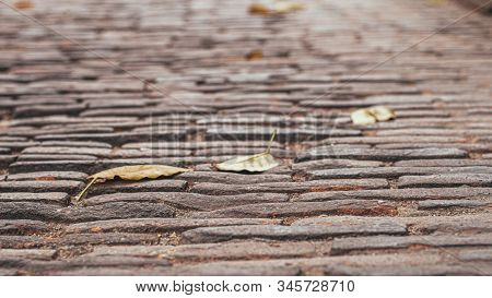 Selective Focused Cobblestone Pavement.vintage Stone Street Road Pavement Texture.pattern Of Stone B