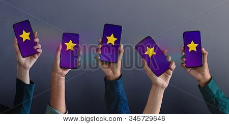 Customer Experiences Concept. Group Of Modern People Giving Five Stars Rating, Positive Review Via S
