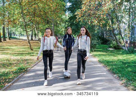 3 Girls Schoolgirls Teenagers 13-15 Years Old, Autumn Day, Summer City, Skateboarding, Happy Smiles,