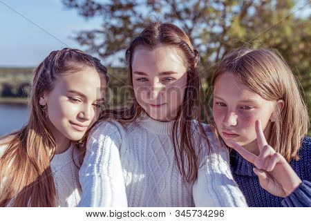 Three Girls Schoolgirls Teenagers 13-15 Years Old, Autumn Day, Summer In City, Selfie On Smartphone,