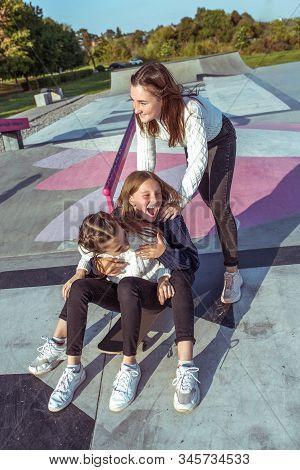 3 Girls Schoolgirls Teenagers 11-13 Years Old, Autumn Day, Summer City, Skateboarding, Happy Smiles,