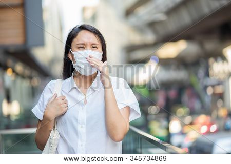 Woman Wearing Face Mask Protect Filter Against Air Pollution (pm2.5) Or Wear N95 Mask. Protect Pollu