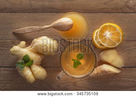 Ginger Tea With Lemon, Honey And Mint On A Wooden Table. Top View