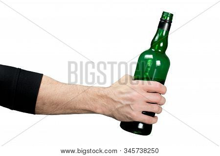 Male Hand Holds A Bottle In His Hand With Alcohol. Isolated