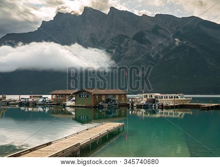 Banff, Canada - August 13, 2019: Panoramic Image Of Lake Minnewanka With Early Morning Mood On Augus