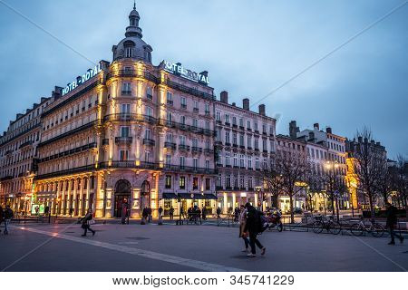 Lyon France , 2 January 2020 : Hotel Le Royal Building View A Luxury Mgalery Hotel At Night And Peop