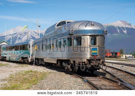 Jasper, Canada - August 20, 2019: Train Of Via Rail Canada In Front Of Mountain Range On August 20,