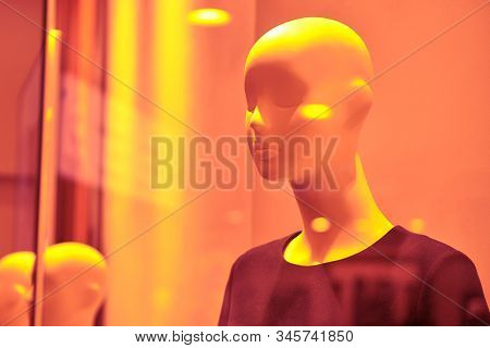Female Bust Mannequin In Light Clothing. Color Of 2020. Lush Lava Toned. Copy Space.