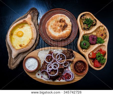 Georgian Cuisine Food Set. Khachapuri, Dolma, Satsivi, Khinkali, Pkhali. Georgian Restaurant. Backgr