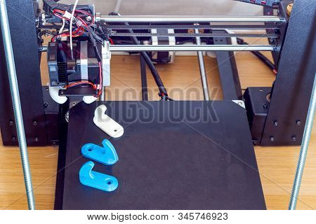 3d Printer And White, Blue Hooks. Thermoplastic
