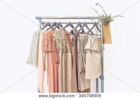 Elegant Dress, Jumper, Trousers And Other Fashion Outfit Pastel Beige Color. Spring Cleaning Home Wa