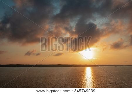 Landscape With Sunset On The Baltic Sea. View Of The Waves And Beautiful Colorful Sunset Sky With Cl