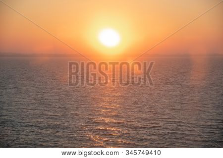 Landscape With Sunset On Baltic Sea. Blurred View Of Waves And Beautiful Colorful Sunset Sky From Th