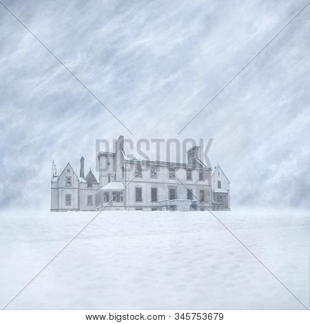 Derelict Old Mansion House Ruin In A Snow-covered Landscape Against A Blizzard Filled Sky Background