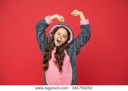 Comfortable Soft Pajamas. Good Morning. Girl In Bunny Pajamas. Child In Rabbit Kigurumi. Happy Girl