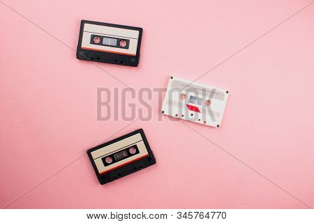 Retro Audio Cassette Flat Lay On Colorful Blue Pink Pastel Background. Top View With Copy Space. Cre