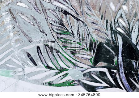 The Abstract Background Of Ice Structure. Ice Sculpture Close Up. Blue Transparent Ice Shapes. Leave