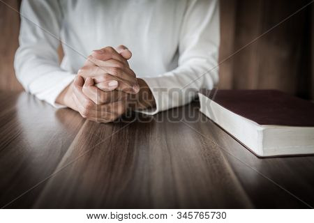 The Girl Wishes To God. In The Hand There Was A Cross And Placed On The Bible. Concept Of Prayer, Pr