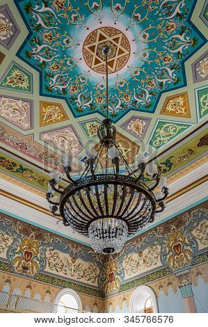 Kutaisi, Georgia, October 13, 2019 : A Large Decorative Chandelier Hangs From The Ceiling In The Old